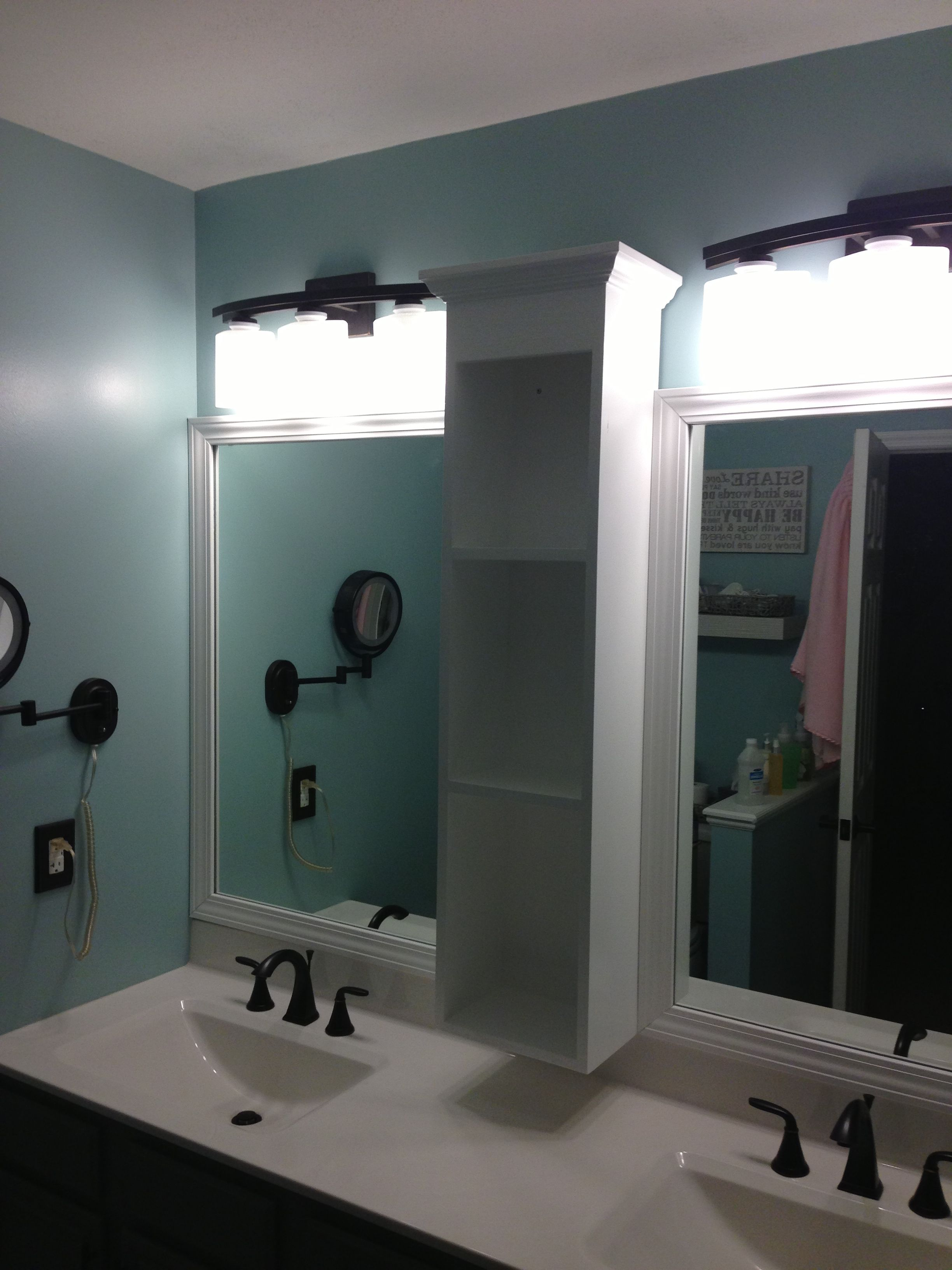 my new updated mirror in the master bath  lighted