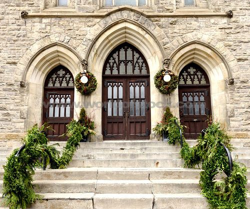Stock photo titled stone steps leading to church doors decorated with christmas ornament for Exterior glass doors for churches