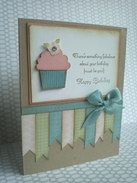 "'Create a Cupcake' stamp set, the Cupcake Builder punch, Crumb Cake cardstock for your card base, Baja Breeze, Blushing Bride and Whisper White cardstock. For the paper ribbon strips I used the 'Twitterpated' (DSP) from the Occasions Mini Catalog cut into various lengths at 1/2"" wide. The bow is made from Baja Breeze Seam Binding attached with a glue dot. For the distressed look, I sponged all edges with Soft Suede"