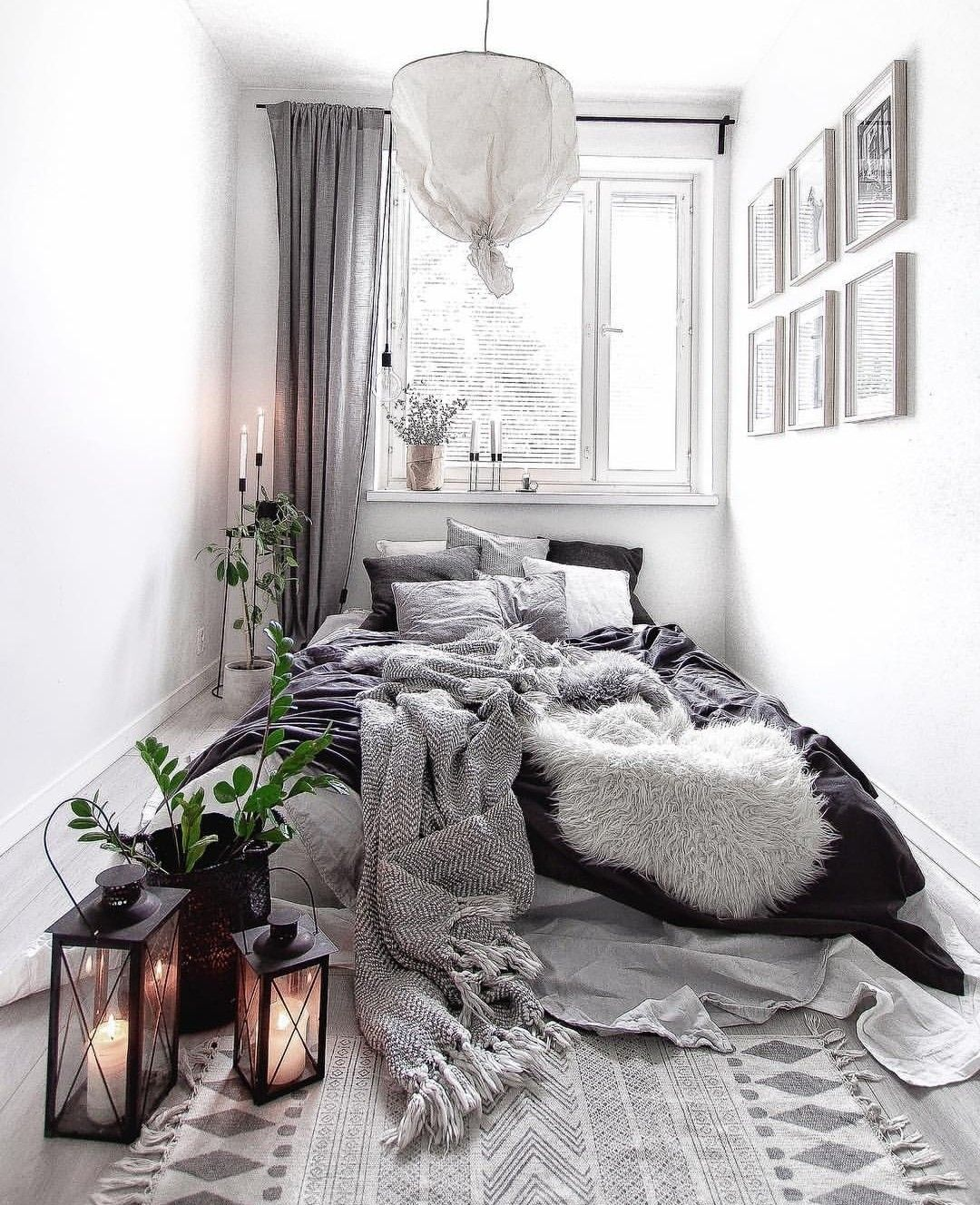 a cozy-looking black, white & gray neutral bedroom with a little of bohemian touch. boh… in 2019