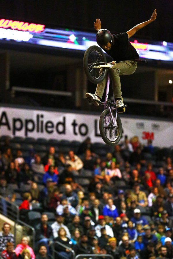 BMX rider from Thriller BMX Team performing a stunt at the FMX World Tour at Budweiser Gardens in London, Ontario.