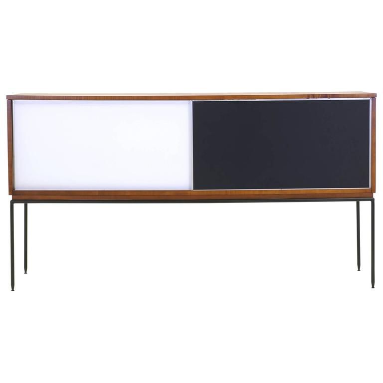paul mccobb planner group cabinet with sliding doors on base with iron legs