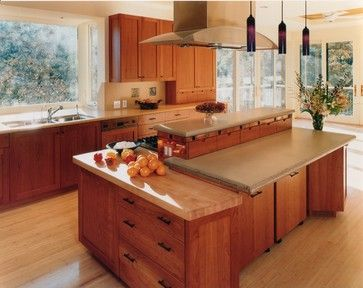 Cherry wood cabinets with light wood floor.