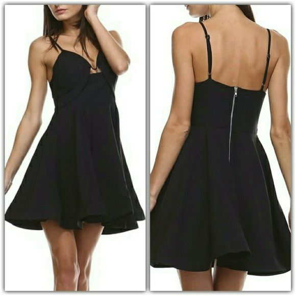 """Structured Black Dress *Small (fits size 0-4): Length: 27"""", Bust: 28"""" *Medium (fits size 4-6): Length: 28"""", Bust: 29"""" *Large (fits size 6-8): Length: 29"""", Bust: 30""""  *Stretch to account for different cup sizes *17"""" adjustable straps *100% polyester *Fully lined *Stiff hemline for structure *Lightly padded bust (no bra needed!) *V-shaped wire along top of bust for structure *Sturdy back zipper *Hand wash cold, hang dry  Price is firm unless bundled. Tea n Cup Dresses Mini"""