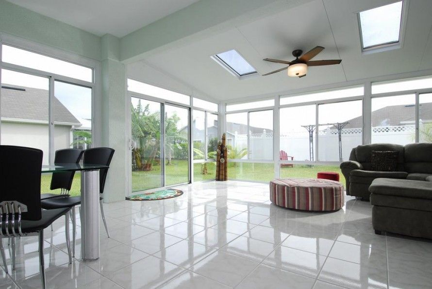 Trendy Modern Sunroom Design Ideas With Ceiling Fans And Black ...