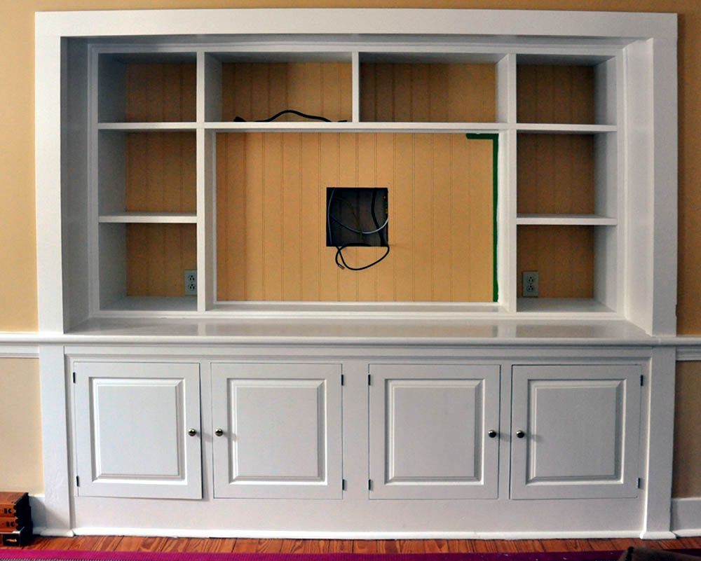 Built in entertainment center designs turn a closet into for In wall tv cabinet