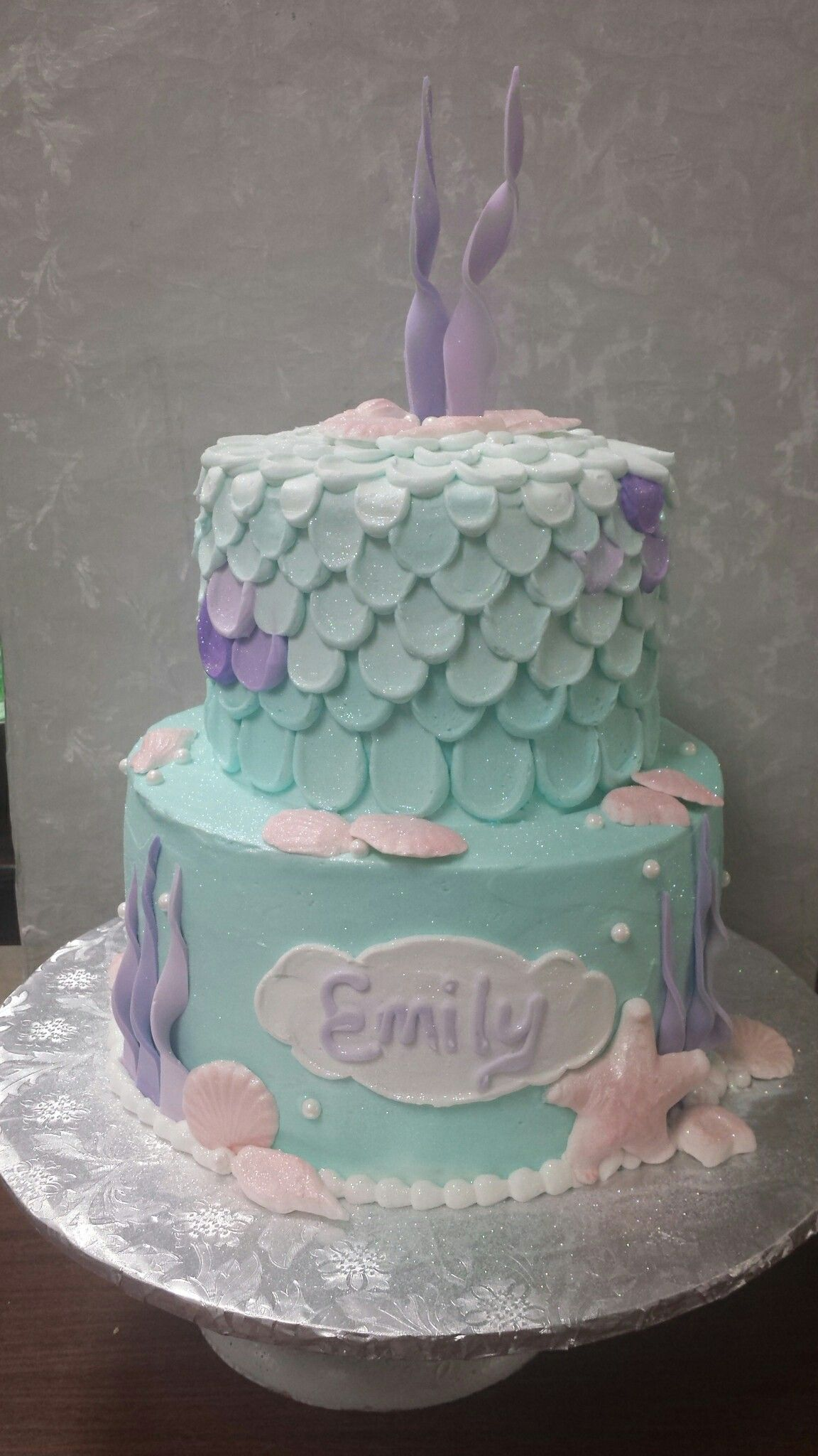 Mermaid themed birthday cake in aqua, pink, and lavender pastels.