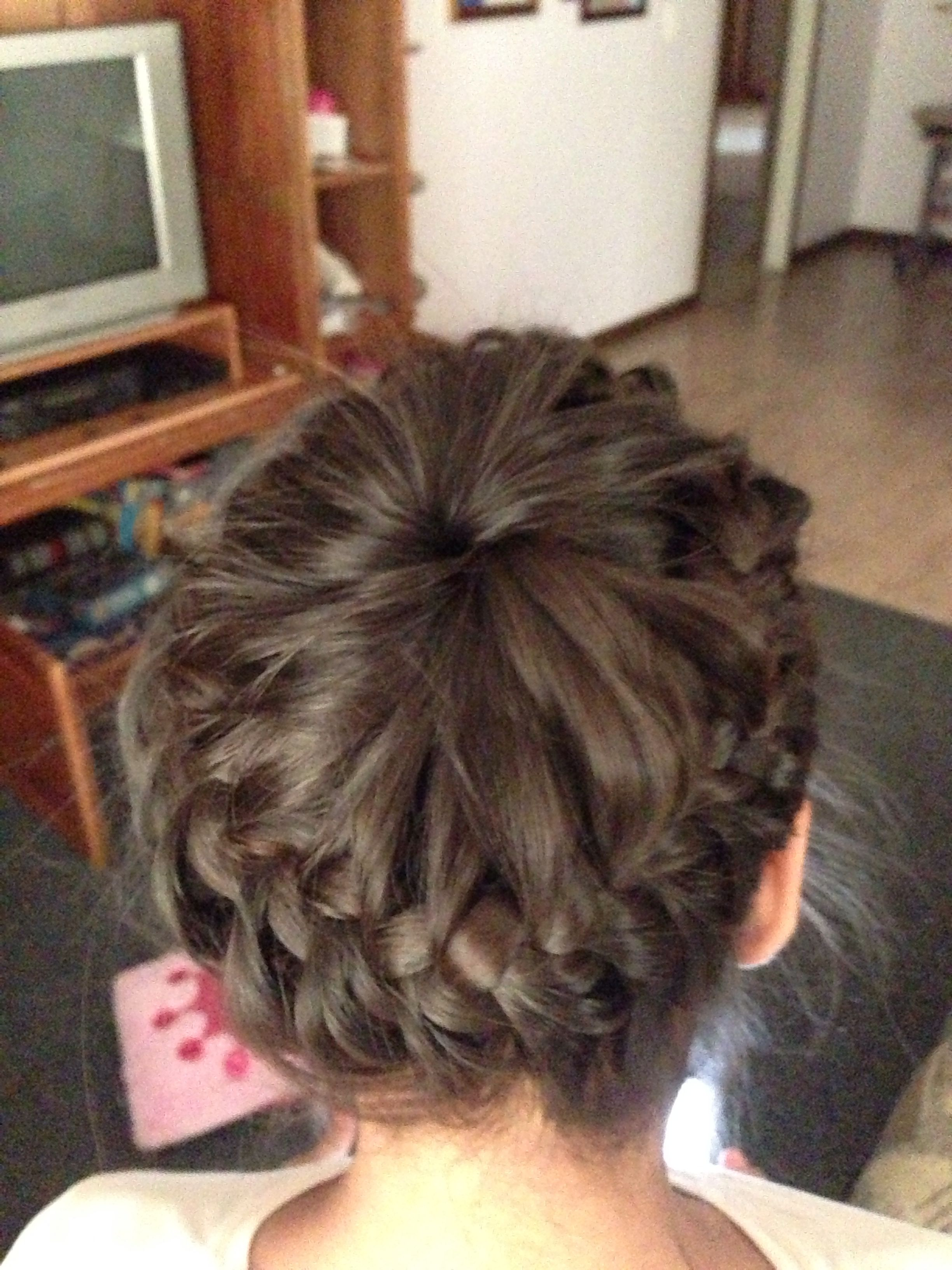 A never ending french braid or also called a starbust crown braid