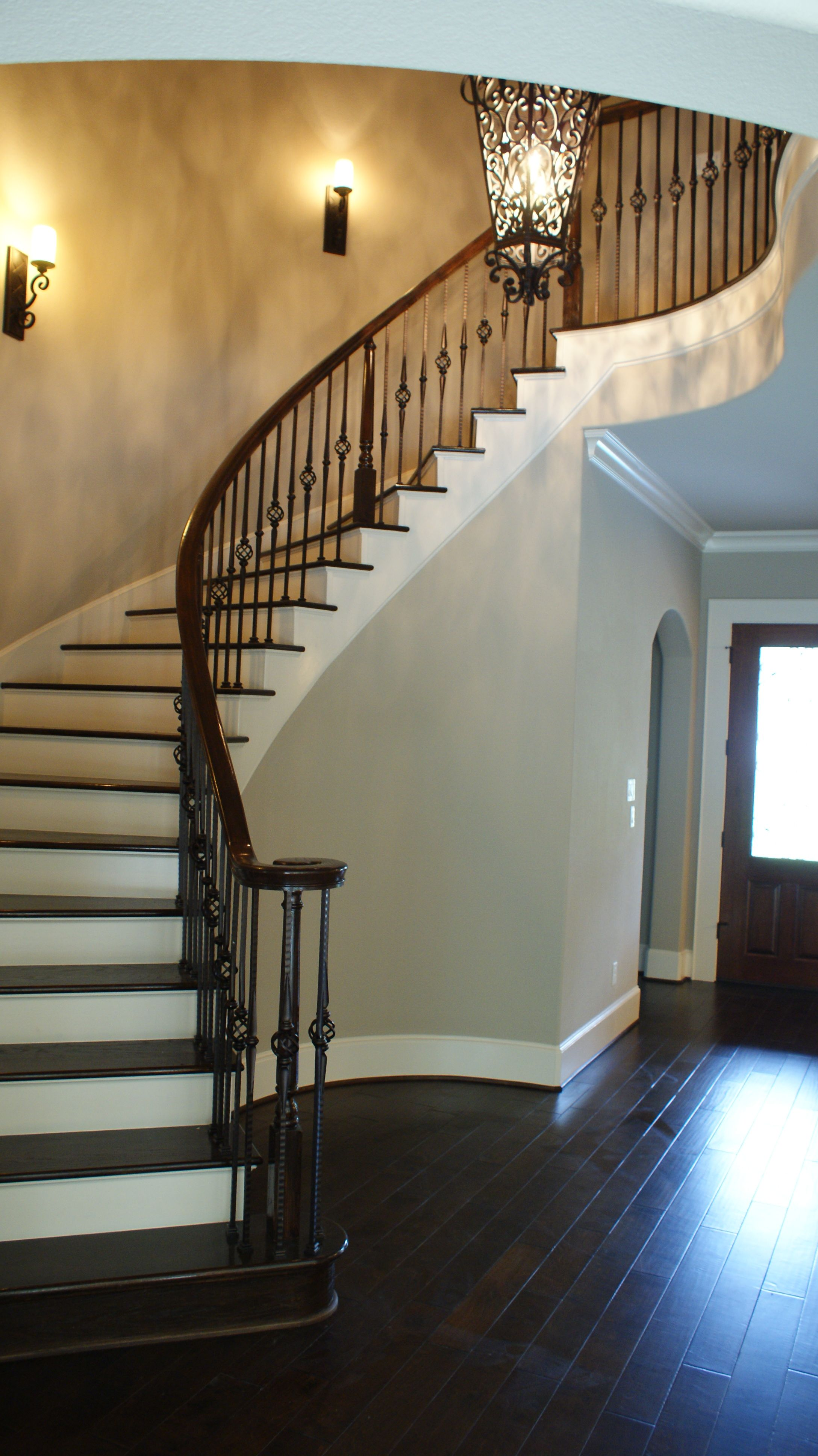 The pleted staircase using our powder coated wrought iron