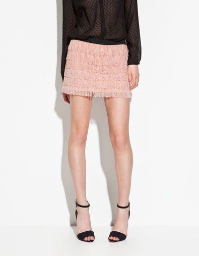 Minifalda rosa de flecos