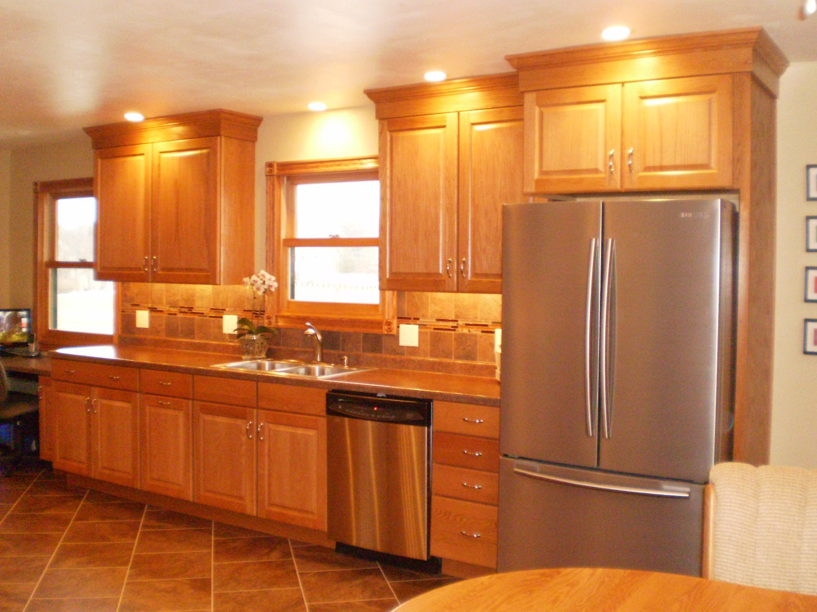 Pin By Floor To Ceiling On Shuman Kitchen Honey Oak Cabinets Oak Cabinets Kitchen Flooring