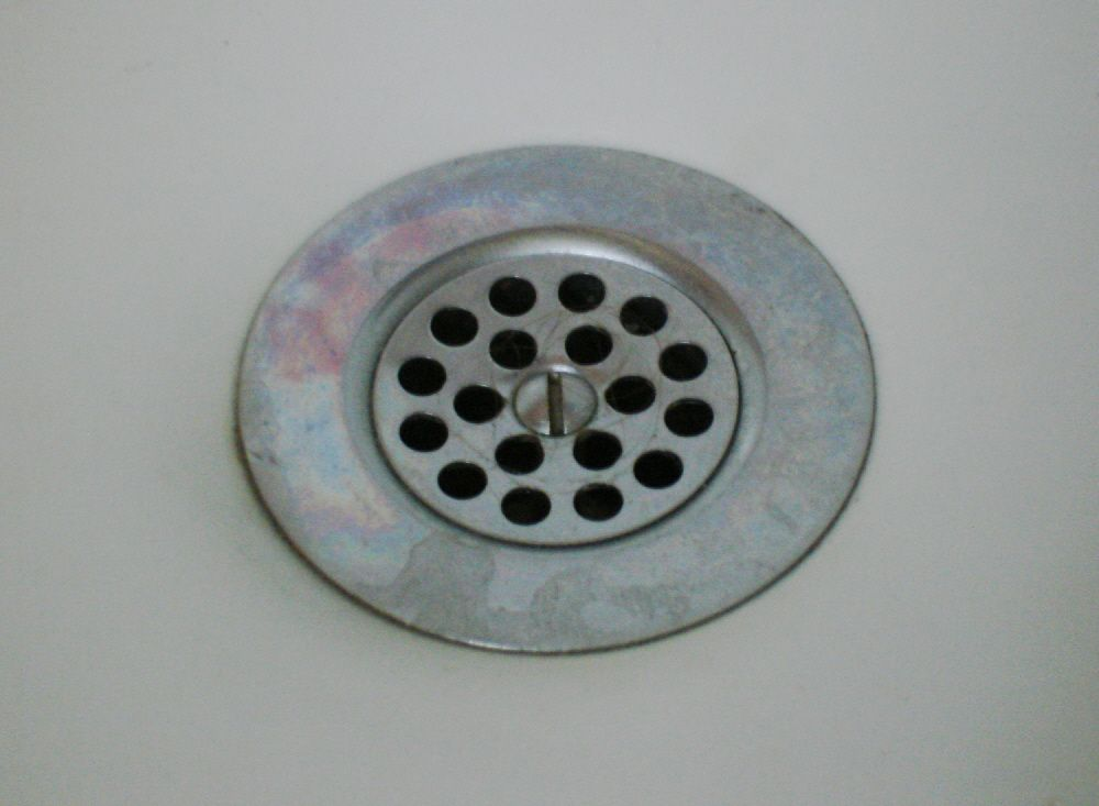 Before cleaning your tub drain, double check if its stopper is ...