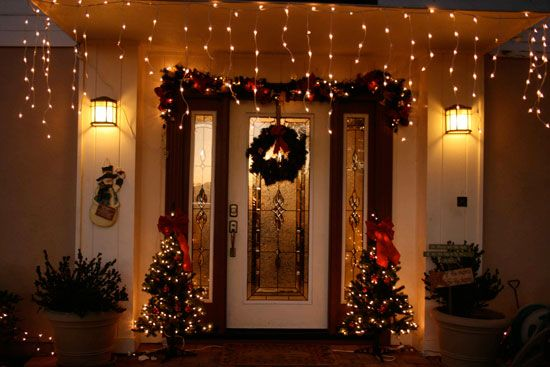 Love the garland above the door--Front Porch Decorating Ideas for