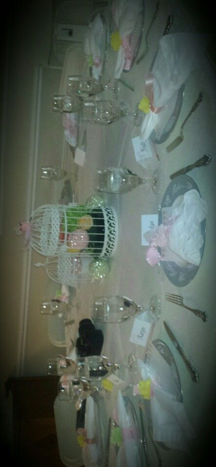 Family heirloom china and fresh flowers in bird cages
