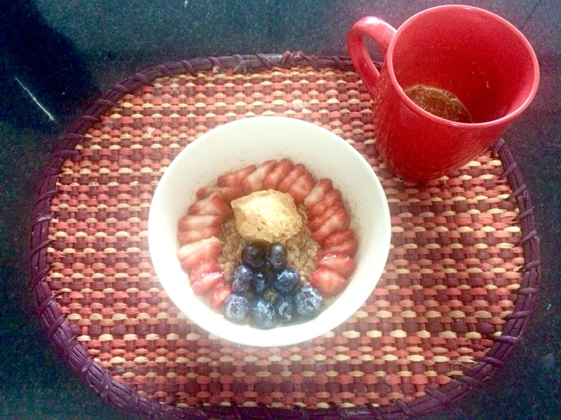 Oatmeal with coffee chia pudding. Toppings: blueberries, strawberries and a big tbsp of natural peanut butter