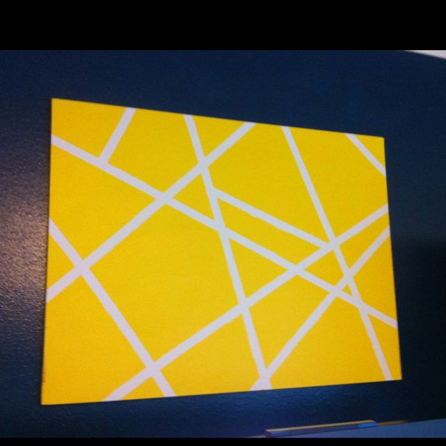 Yellow and white masking tape canvas on navy wall | real life isn\'t ...