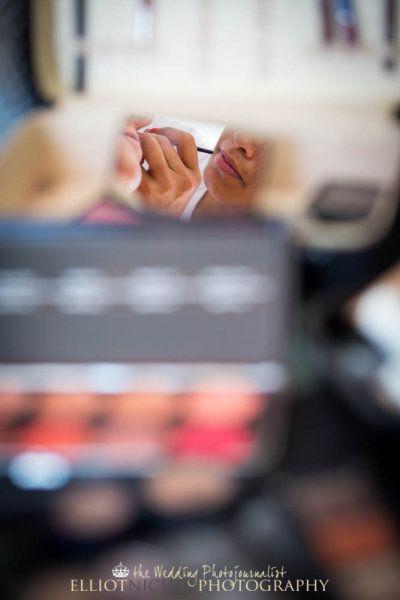 Abstract Image Wedding Makeup Artist Applying Makeup To Bride