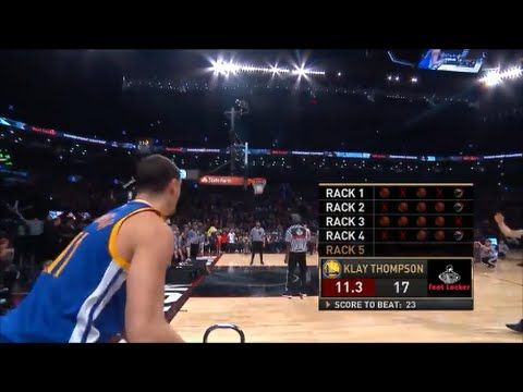 Klay Thompson knocks off his teammate Stephen Curry to win the Foot Locker Three-Point Contest....