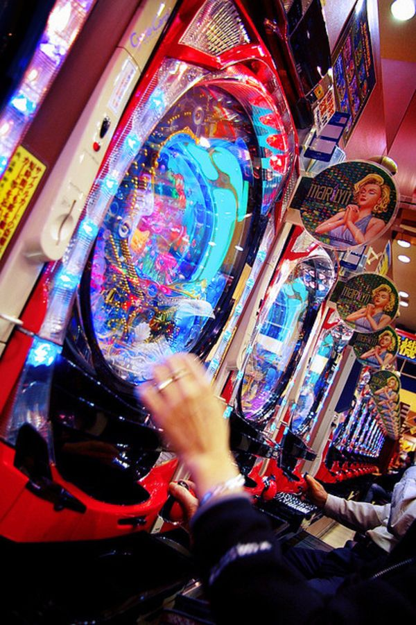 """Pachinko is a Japanese arcade style slot machine. Every year Japanese people spend US $300 Billion at Pachinko. That's about twice the entire GDP of a country the size of New Zealand (US $127 Billion). ... Gambling is technically illegal in Japan. Inside the pachinko parlor balls can be exchanged for superficial prizes such as medals. There is always a small ""shop"" just outside that exchanges the medals for cold hard cash. ..."""