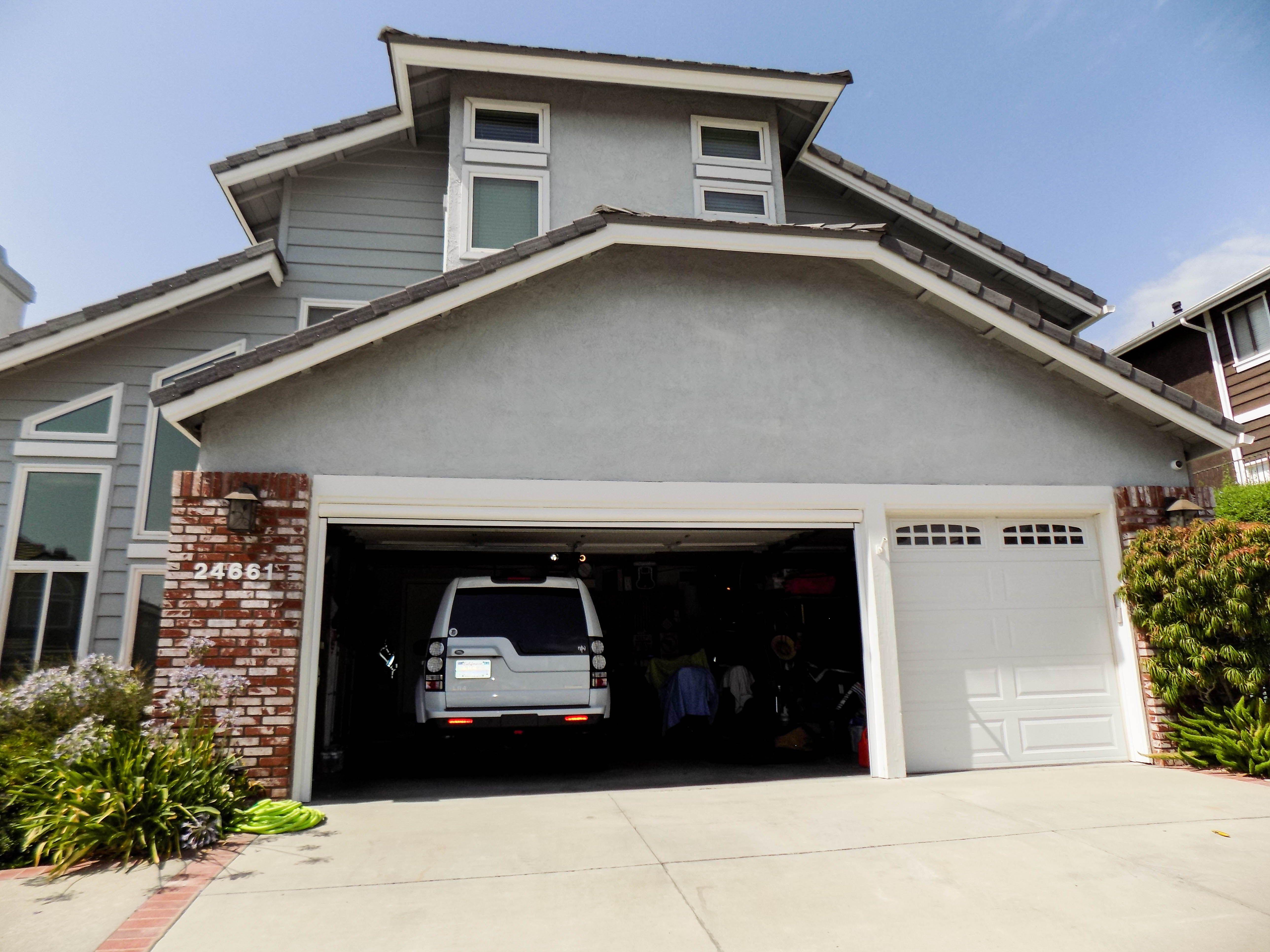 We Installed A Motorized Power Screen On A Garage Door In Laguna Hills California In Orange County Fo With Images Traditional Style Homes Garage Doors Garage Screen Door