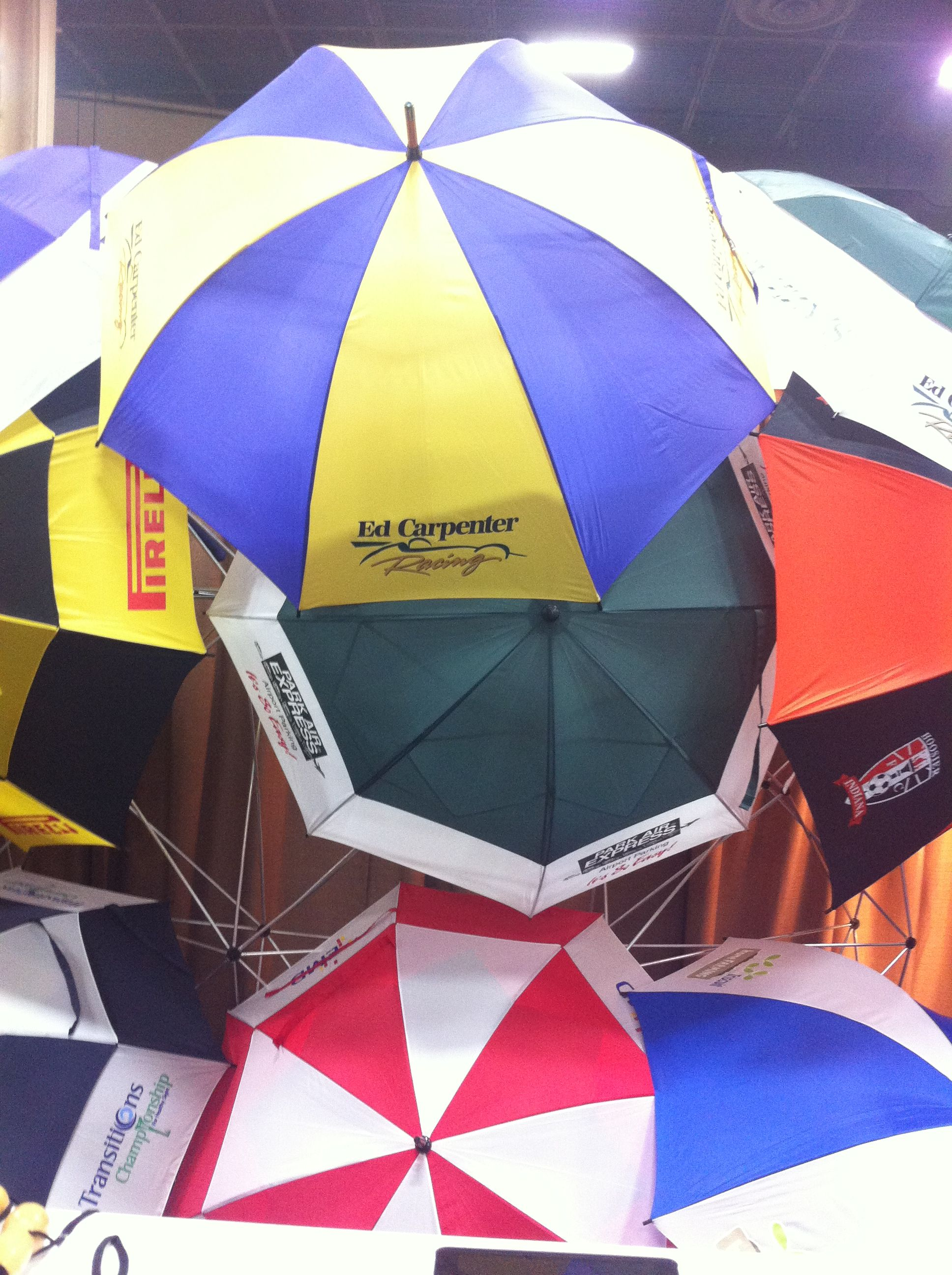 Umbrellas, ponchos, rain gear with your logo.  From Storm Duds
