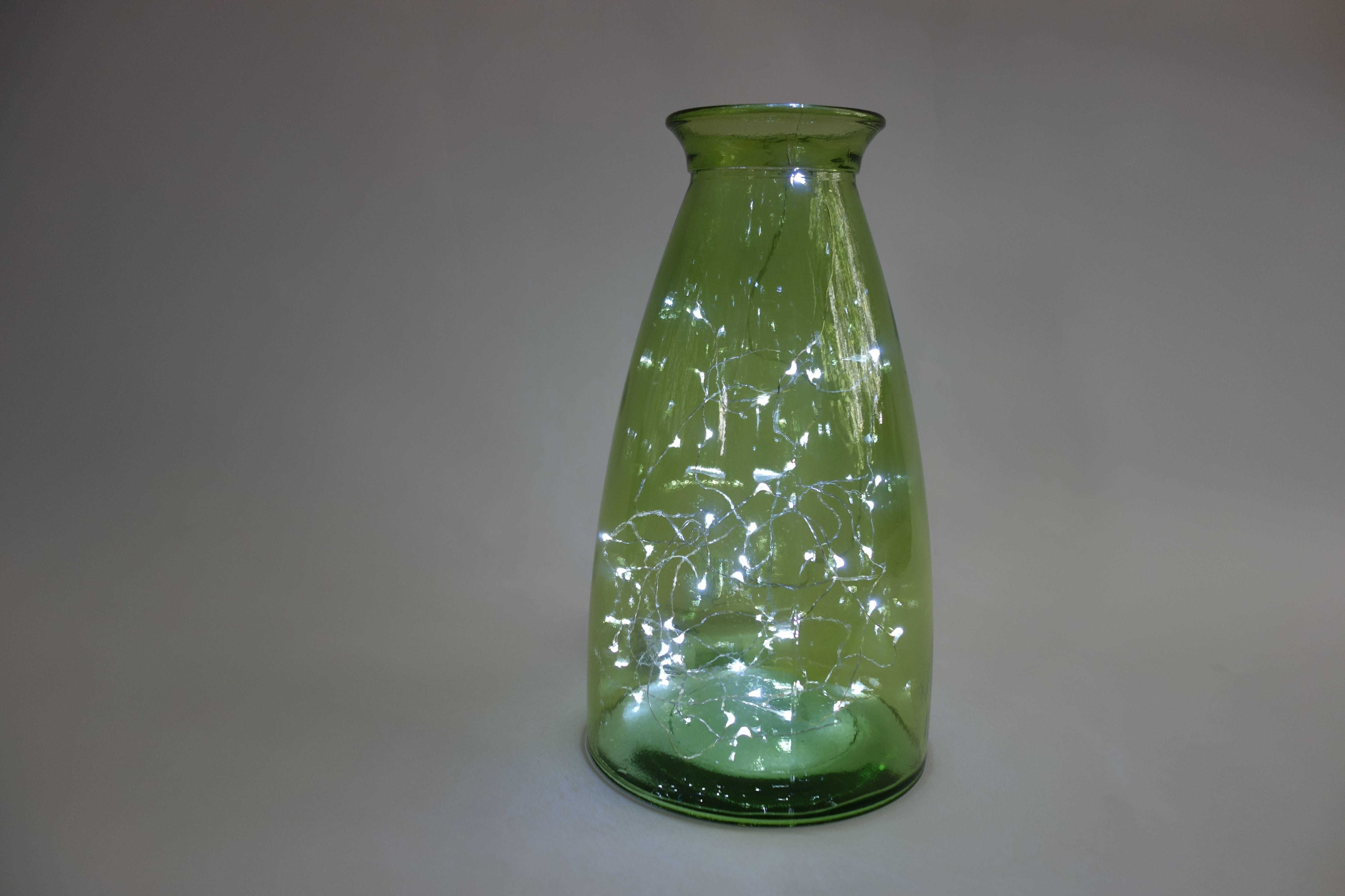 Photo of Utvalg av vaser og flasker med fe lys ideell for sommer BBQ fester, x …
