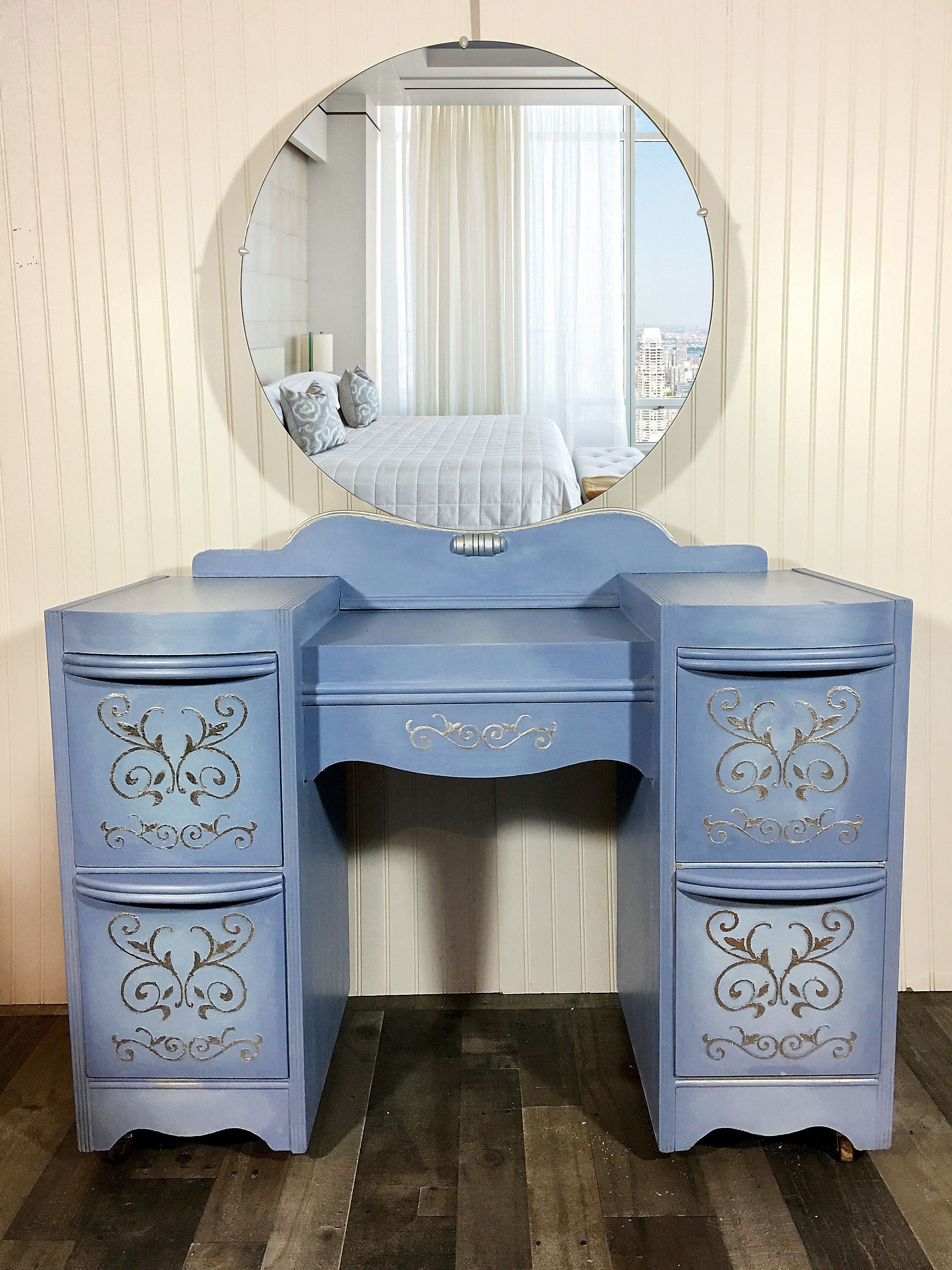 Sold vintage vanity upcycled in blended blues and silver leaf