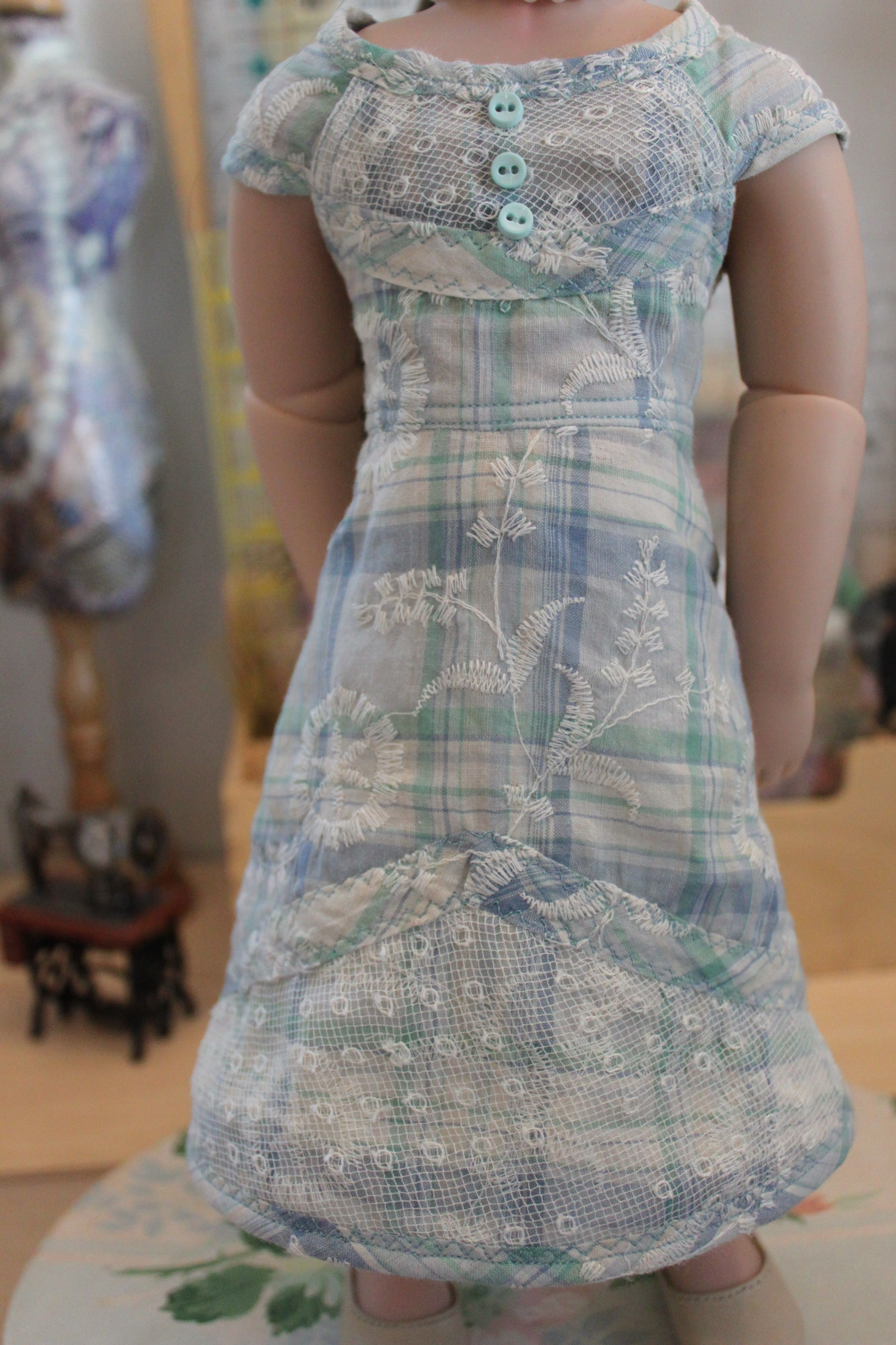 Closeup of the lace and embroidery on the fabric i used a girl