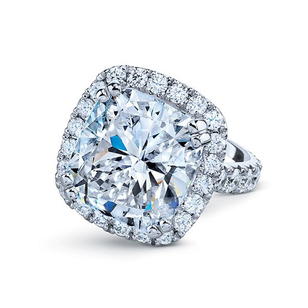 Unbelievable 10ct Cushion cut center accented by 1.76ct\'s or round brilliant diamonds.