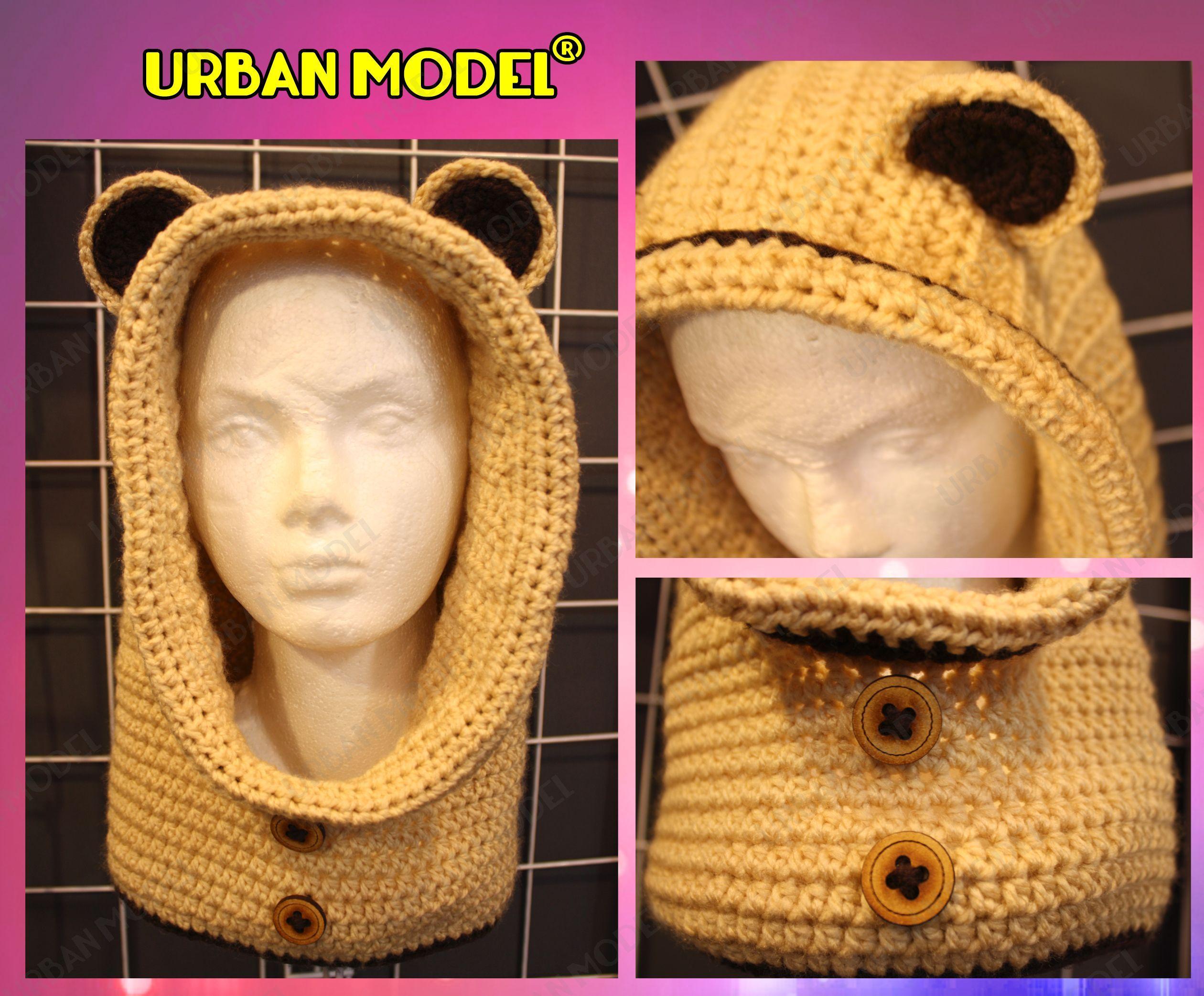 Gorro teiido de oso en color mostaza, botones de madera. Precio en tienda $350.00