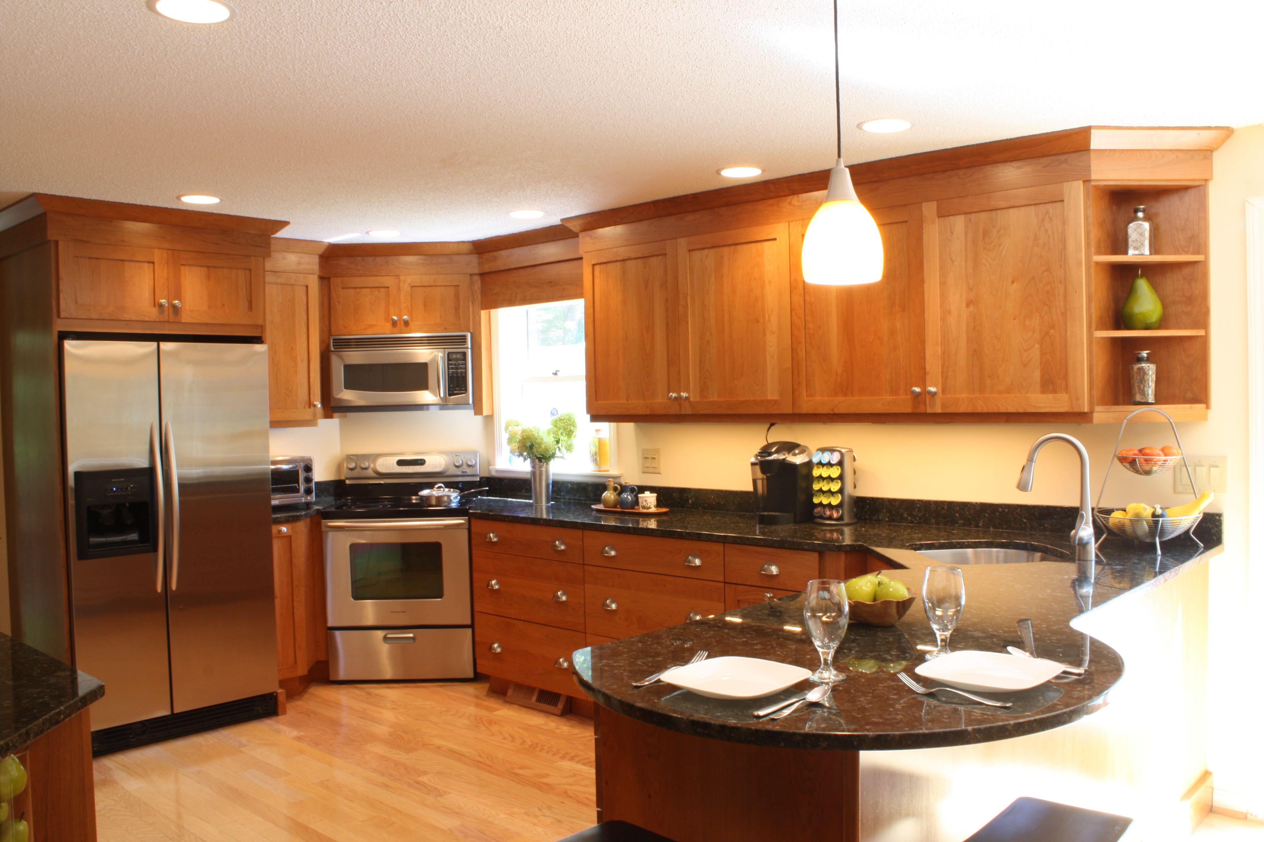 Cherry wood cabinet kitchen stainless steel appliances corner sink