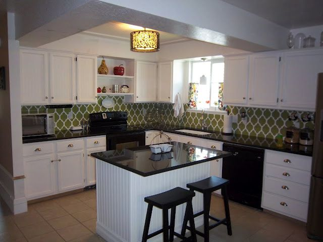 Nice Green Tile With White Cabinets And Black Countertop For The