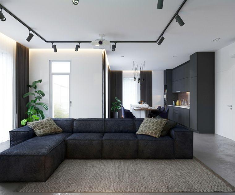 Cucina soggiorno ambiente unico, divano ad angolo nero, pavimento in ...