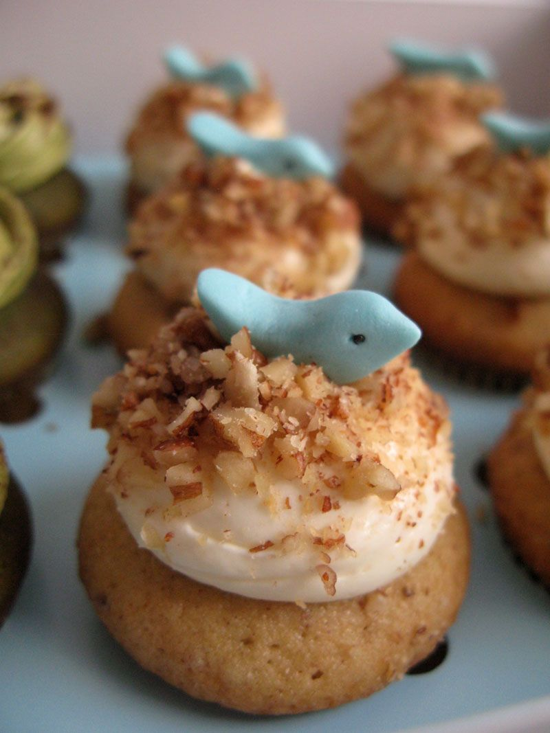 Hummingbird! My favorite and best seller cupcakes! Classic cupcakes, with fresh banana, pineapple, and little bit cinnamon flavor. Cheese cream frosting, covered with baked chopped pecan nuts, and little blue fondant bird on top.