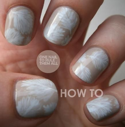 This feather nail art looks light and pretty, and it's simple to achieve using a nude base and a small paintbrush. #NailArt #NailDesigns