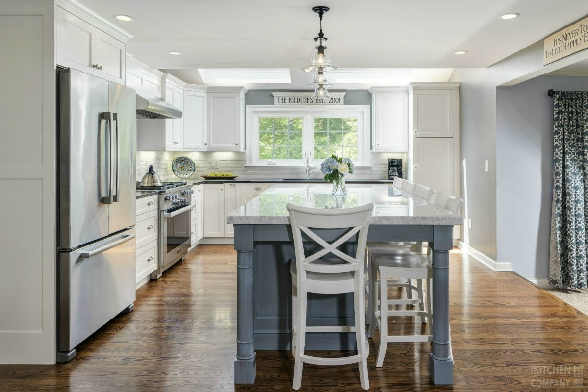 A Bright And Cheerful Kitchen Cabinetry Woodmode Brookhaven With Nordic White Finish Island Vintage Transitional Kitchen Design White Kitchen Kitchen Design