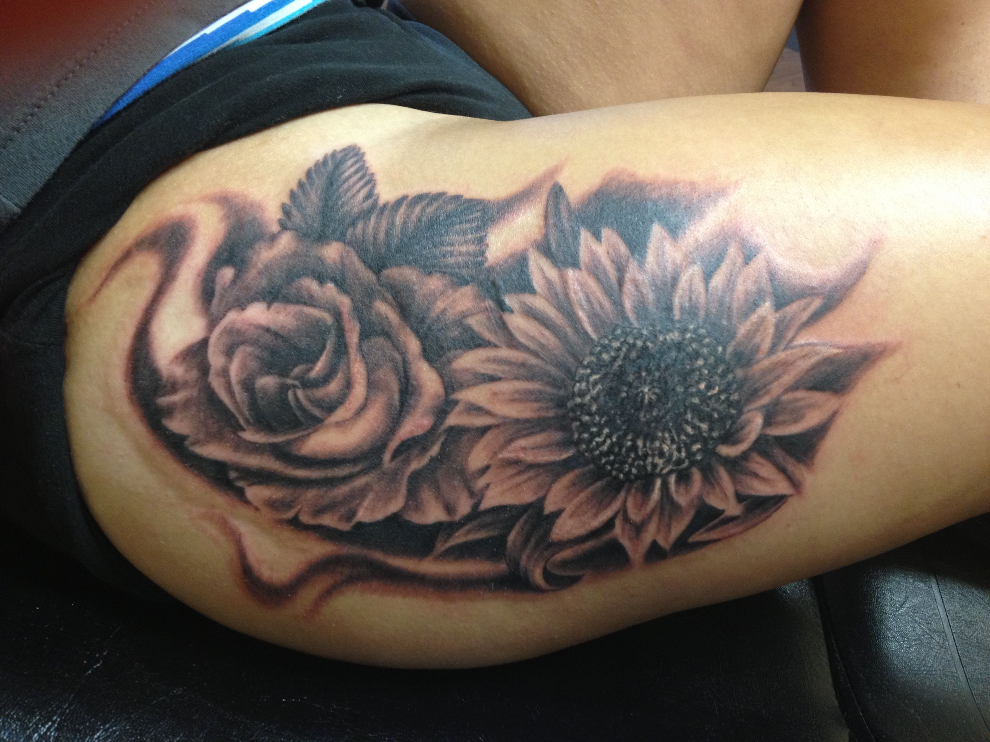 Sunflower and rose tattoo done by tyler walstrom tattoos for Sunflower tattoo thigh