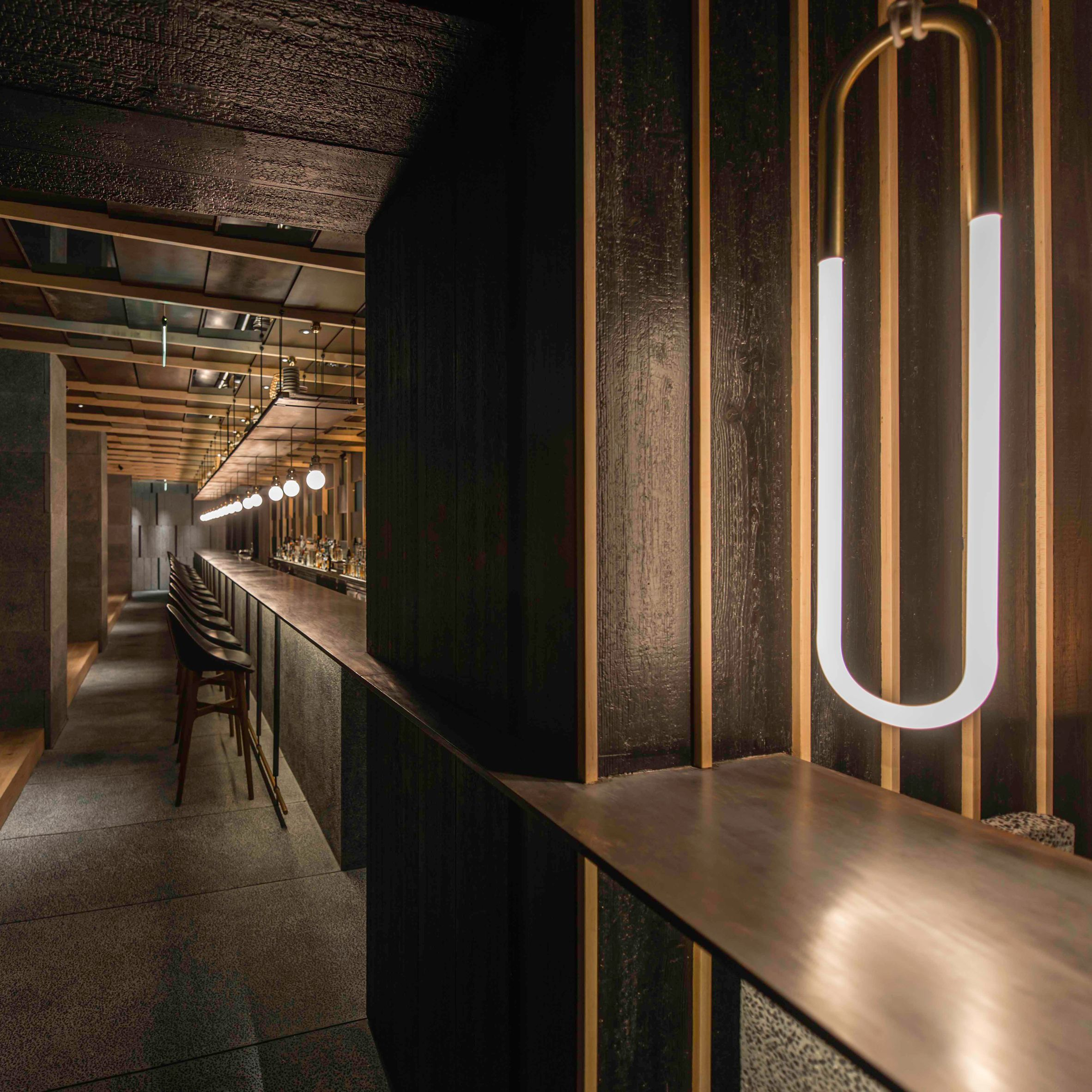 chinese studio nerihu has designed a long communal table and suspended lighting that creates a