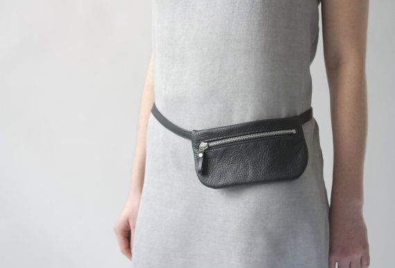 Unique flat belt bag made of soft italian leather in black.  Perfect for festivals, a night out, travelling and as a safe place for your phone or