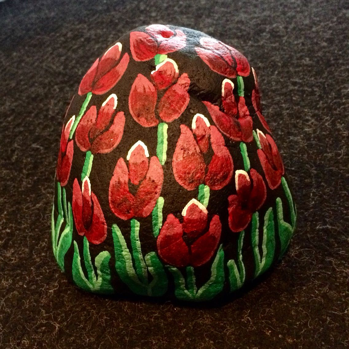Tulips painted on a rock by Linda Hallett.