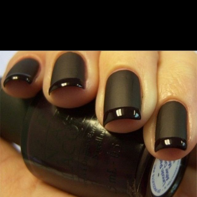 Matte black nails with a high gloss tip.