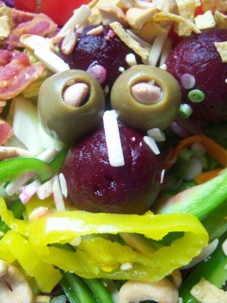 Mediterranean foodie face with olives and chillies