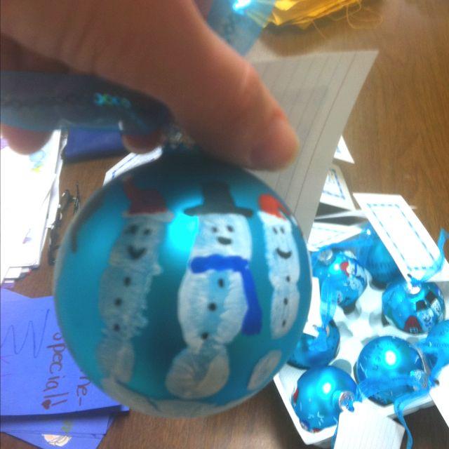 Handprint snowmen ornaments.... Their fingers are the snowmen :)