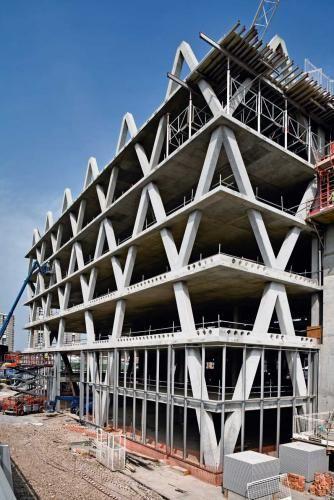 Concrete Frame Building : The yellow building ahmm concrete frame perimeter