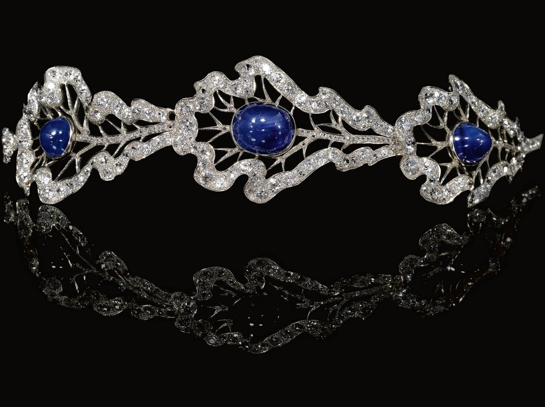 The Sapphire Oak Leaf Bandeau Tiara, THURN UND TAXIS FAMILY dated Regensburg,1932. Attractive sapphire and diamond bandeau, Set with three articulated oak leaves, each accented with a cabochon sapphire, the central a star sapphire, embellished with rose, circular-cut and cushion-shaped diamonds.