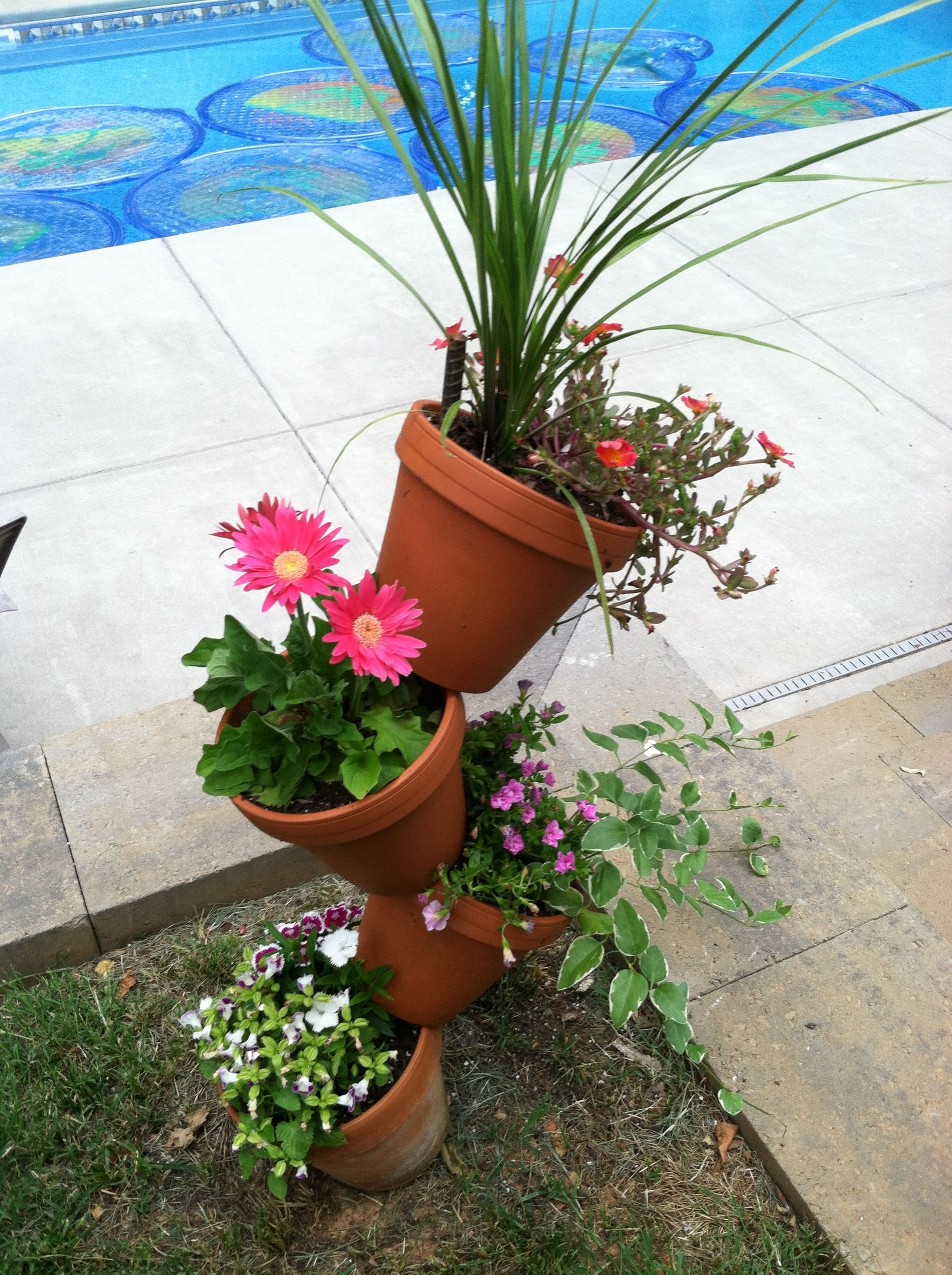 Tower Of Flowers Pound Rebar Into Ground Stack Pots And Tilt In Opposite Directions Plant Your Favorite Flowers Bes Container Gardening Stacked Pots Plants