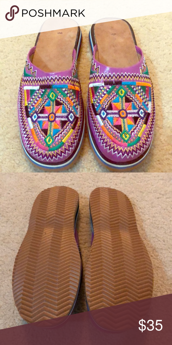 c2955a91f744 Brand new Moroccan slip on shoes! Handmade leather in purple with  multicolored Berber design. The size says 40 but it fits as a size 9.
