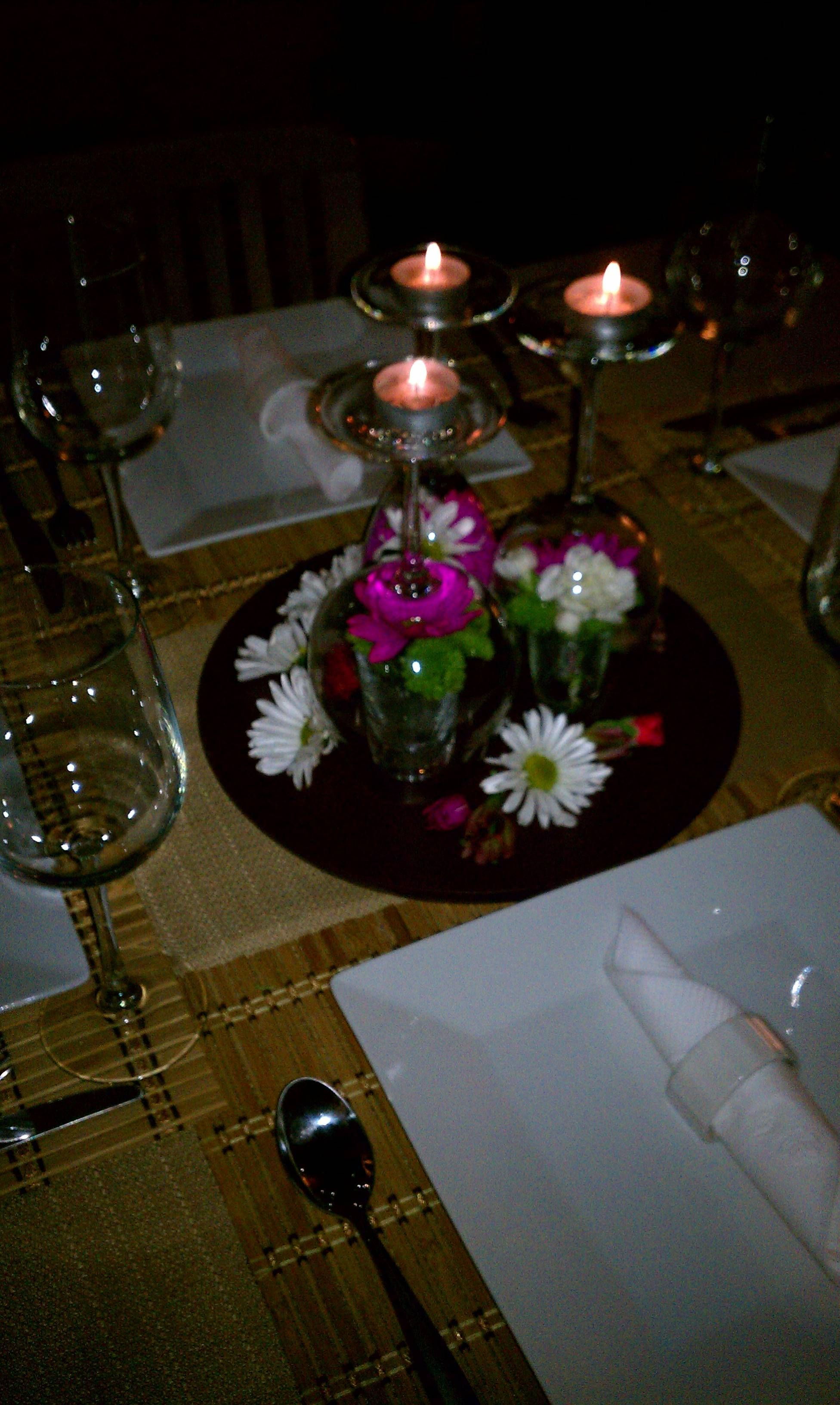Awesome centerpiece shot glasses with flowers then an