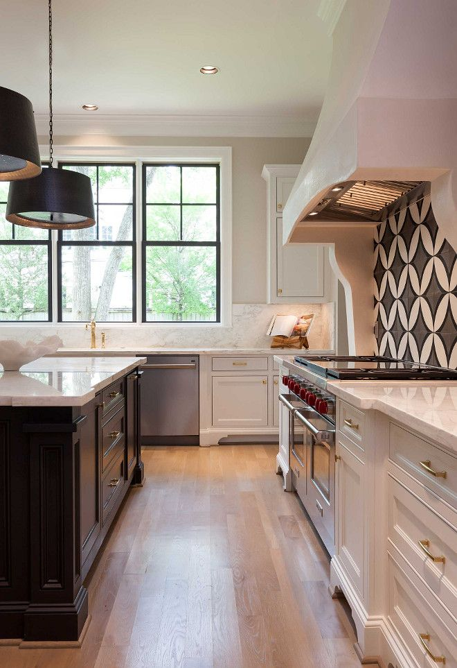 white kitchen with dark island cement tile backsplash and white oak hardwood floors elizabe on kitchen remodel dark floors id=69437
