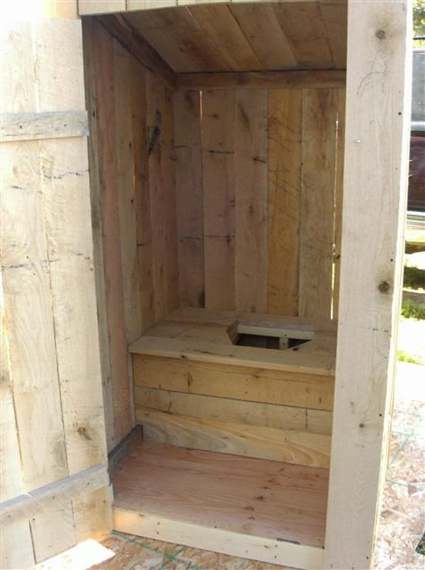 Bigger Round Outhouse With Wooden Toilet Seat And Large Metal Can